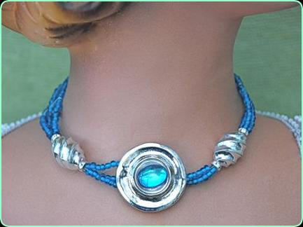 Designer blue and silver choker necklace with large silver disc centre piece with a blue stone
