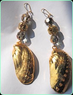 Designer gold colour and glass earrings with a large gold shell drop
