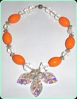 Designer crystal and orange beads with three  large crystals drop